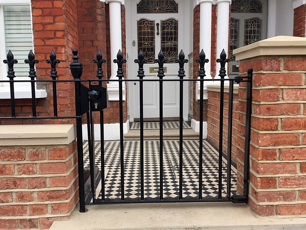 brick wall fulham chelsea metal gate and rail mosaic tile path victroian black and white with two line border london