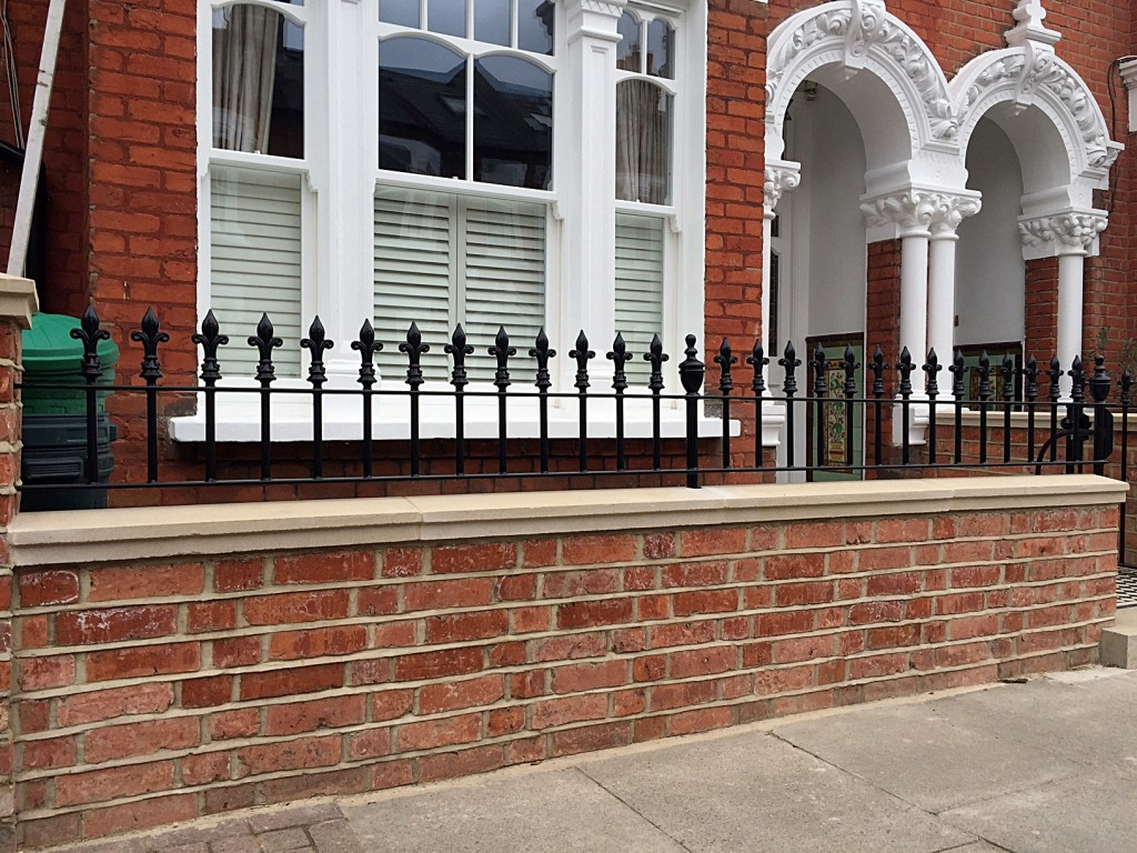 clapham battersea red brick wall with coping caps and 20mm rail london