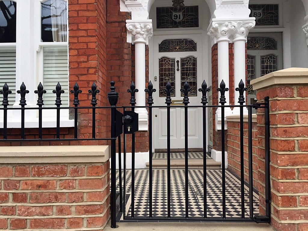 red brick wall rail and gate coping caps fulham chelsea battersea clapham london