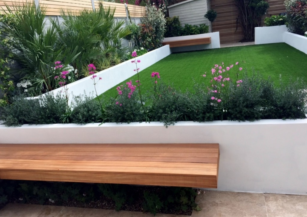 artificial grass raised render painted beds travertine paving grey fence hardwood floating bench modern low maintenance architectural planting balham clapham brixton london