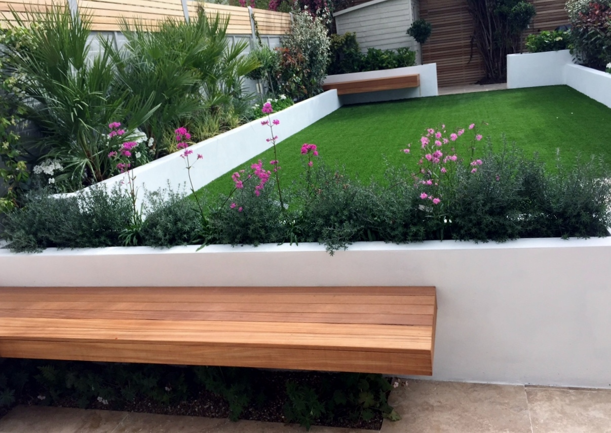 superb small garden paving ideas #6: artificial-grass-raised