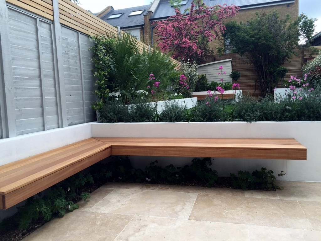 floating hardwood bench travertine paving raised beds brixton clapham streatham garden design designer london