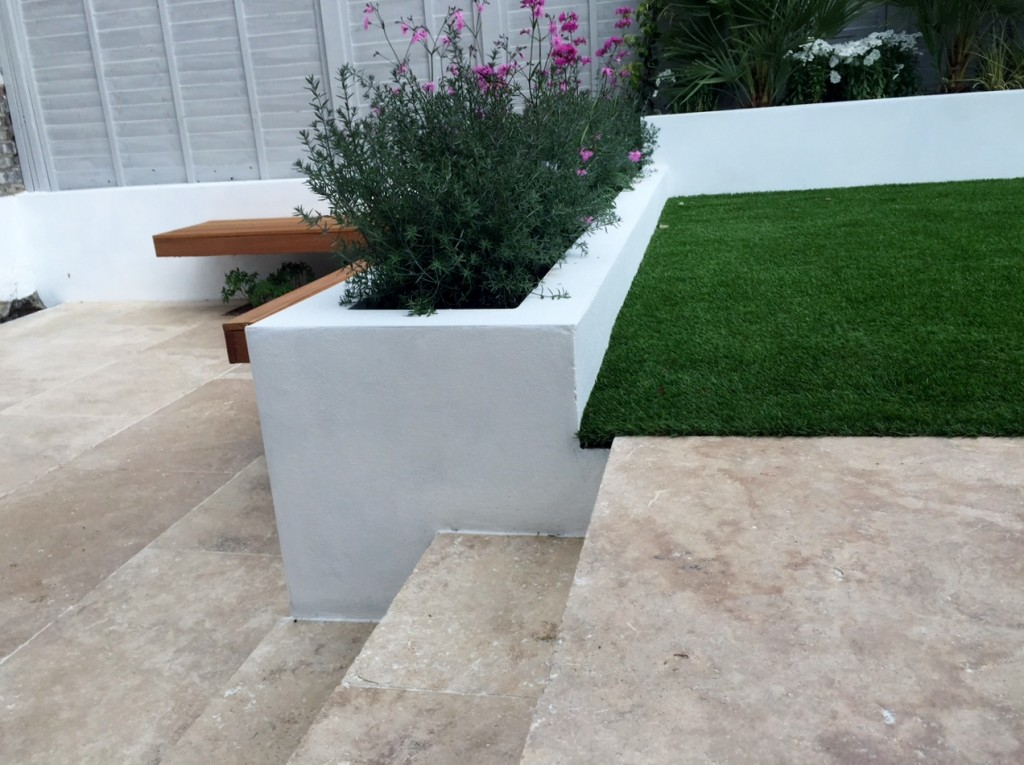 travertine garden steps and raised beds flaoting bench garden design london