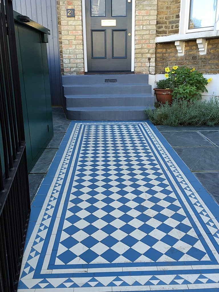 Blue and white victorian mosaic tile path slate paving yellow brick garden wall metal rail and gate