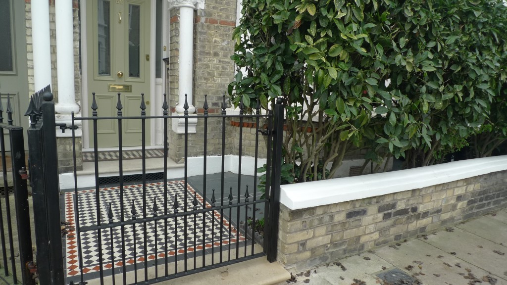 Ornamental stone Victorian mosaic  multi colour metal gate metalrail brick garden wall render garden wall York stone entrance stone Balham Clapham Battersea London