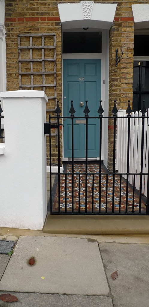 Ornamental stone Victorian mosaic multi colour mosaic metal gate metal rail brick garden wallrender garden wall York stone entrance stone Earsfield Wimbledon Putney Wandsworth London