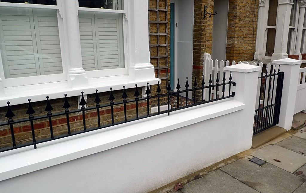 Ornamental stone Victorian mosaic multi colour mosaic metal rail metal gate brick garden wall York stone entrance stone render garden wall Earsfield Wimbledon Putney Wandsworth London