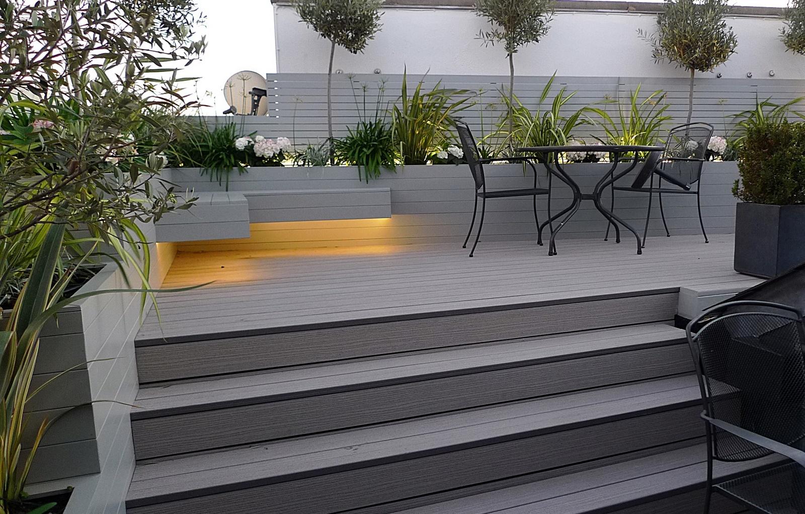 Raised beds formal clapham balham painted fence trellis for Grey decking garden ideas