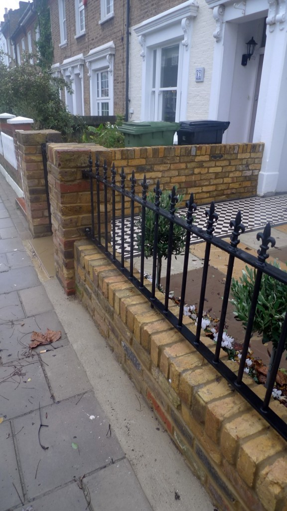 Yellow brick metal gate planting London front garden design