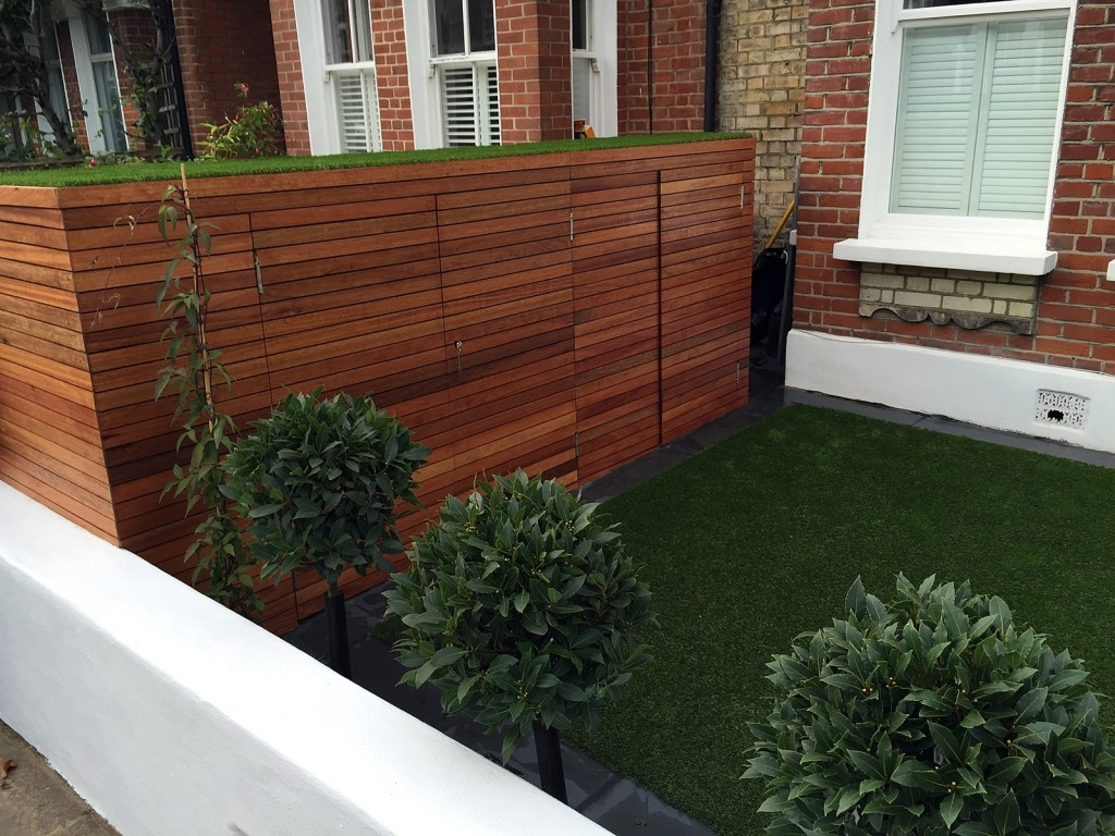 bespoake bike bin store with artificial grass roof and topiary planting simple low maintenance garden design battersea clapham balham fulham chelsea london
