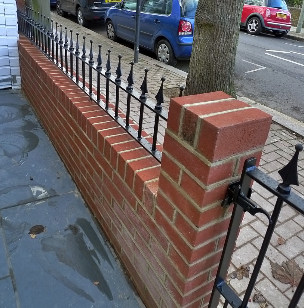 Brick red garden walls fence Balham Battersea Wandsworth Clapham iron gate rail render London
