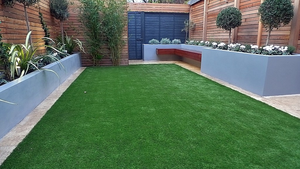 Chelsea Dulwich London artificial grass topiary planting fence grey walls raised beds Streatham Clapham