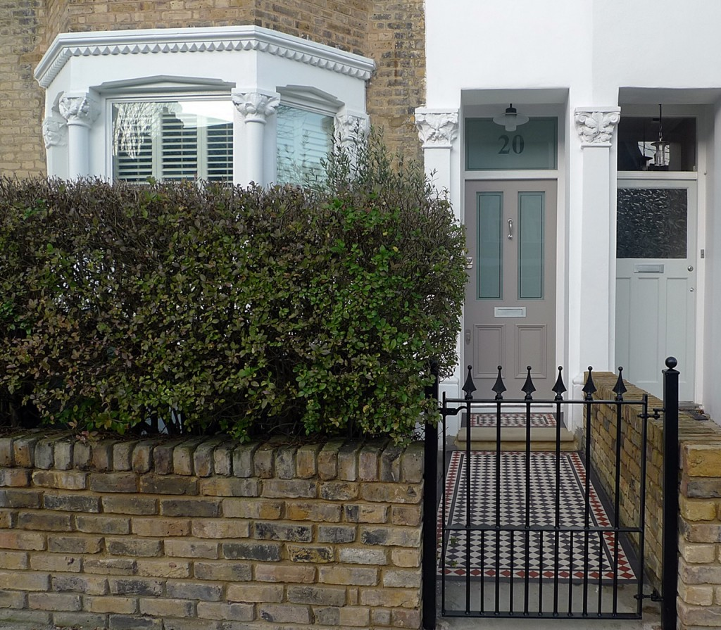 Fence planting yellow brick privacy low maintenance render iron bespoke gate metal rail London Dulwich Peckham Battersea Clapham Balham