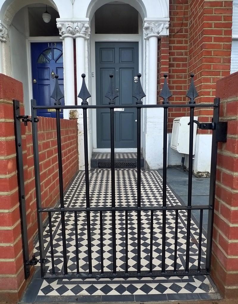Metal gate rail render garden brick red walls grey tile formal mosaic London Earsfield Wandsworth Battersea Clapham