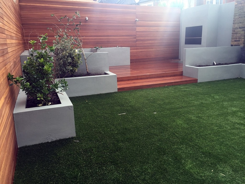 Artificial grass hardwood planting grey walls London Balham