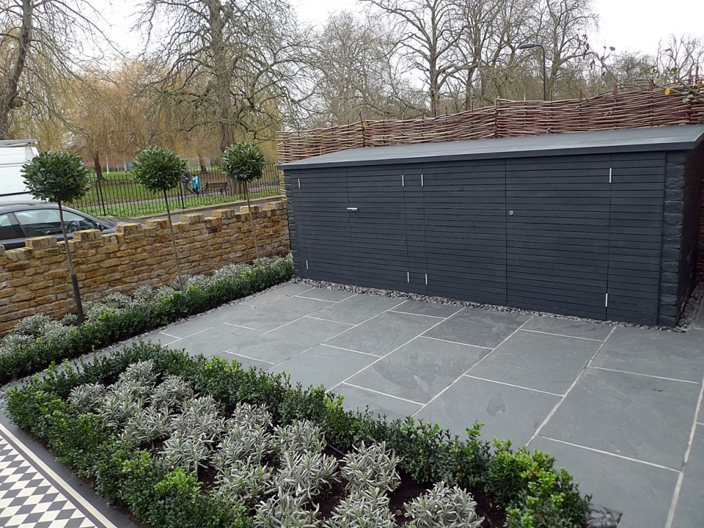 Topiary storage bin grey tile planting London brick garden wall Wandsworth Battersea Clapham