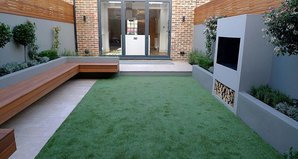modern garden designer london artificial grass hardwood seat fireplace hardwood slatted cedar screen trellis fulham london