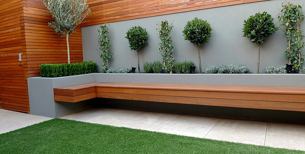 modern garden designer london artificial grass hardwood seat fireplace hardwood slatted cedar screen trellis islington hackney london