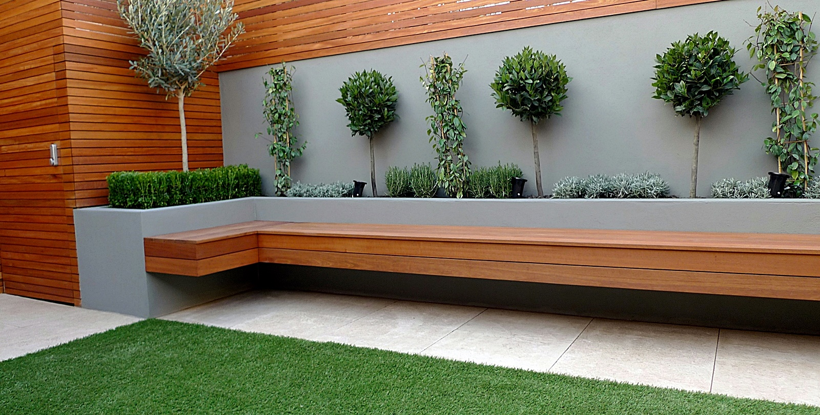 Modern garden designer london artificial grass hardwood for Modern garden