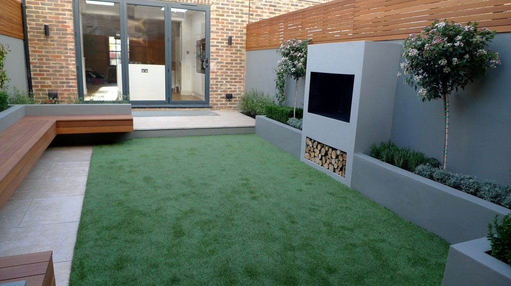 modern garden designer london artificial grass hardwood seat fireplace hardwood slatted cedar screen trellis mayfair london