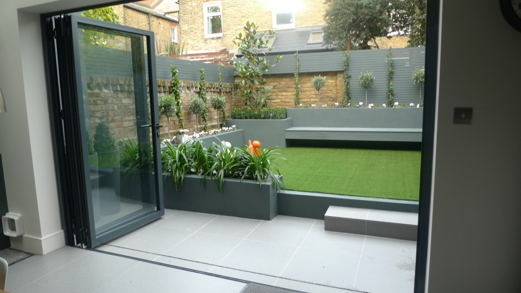 modern small low maintenance garden fake grass grey raised beds contemporary planting cheam london