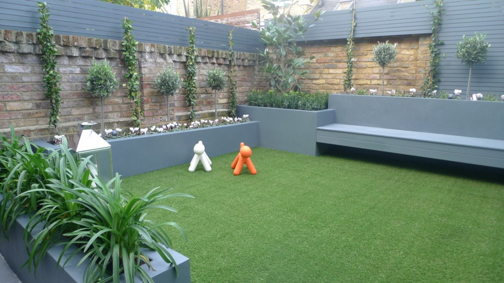 modern small low maintenance garden fake grass grey raised beds contemporary planting dulwich london