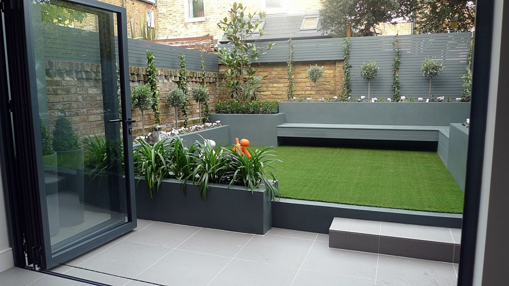 modern small low maintenance garden fake grass grey raised beds contemporary planting fulham london
