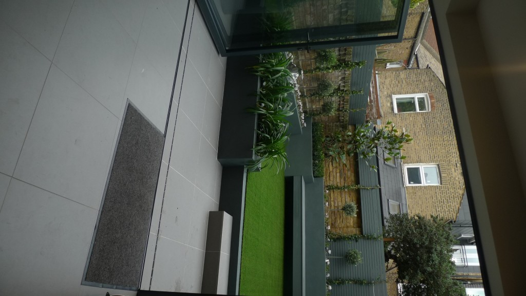 modern small low maintenance garden fake grass grey raised beds contemporary planting pimlico london