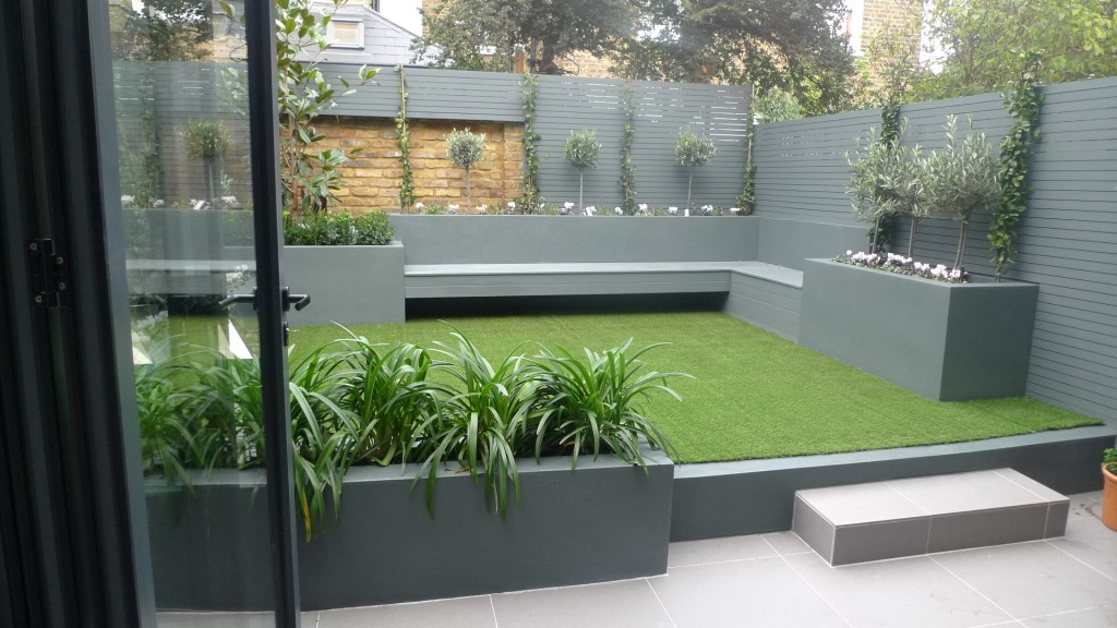 modern small low maintenance garden fake grass grey raised beds contemporary planting westminster london