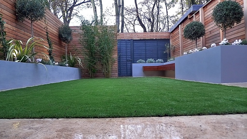 Artificial grass tile grey colour scheme walls fence planting modern design London Streatham Dulwich Clapham