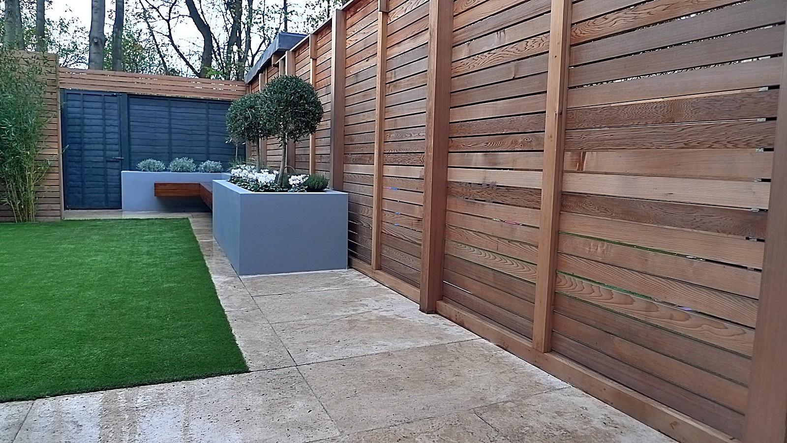 Artificial grass tile grey colour scheme walls fence for Garden fence designs uk