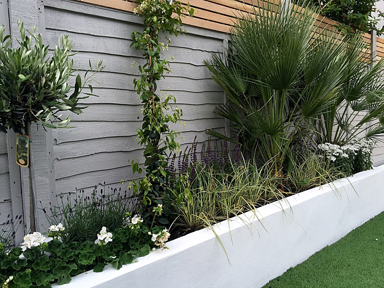 Artificial london garden design for White garden walls