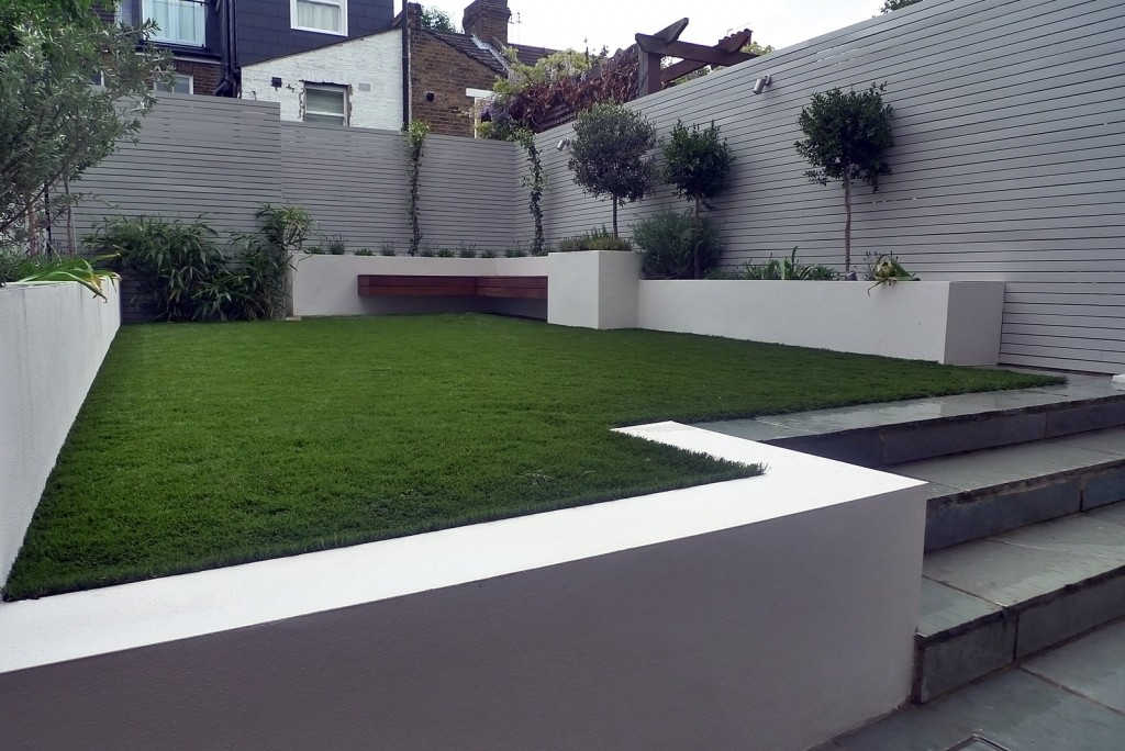Artificial grass planting white painted fences raised beds Westminster Fulham Chelsea Kensington