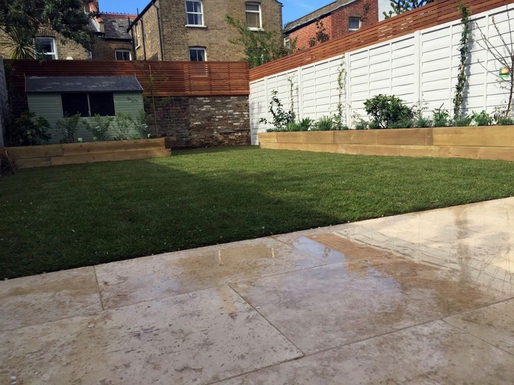 Hardwood privacy screen travertine paving fencing painted planting grass London Dulwich Battersea