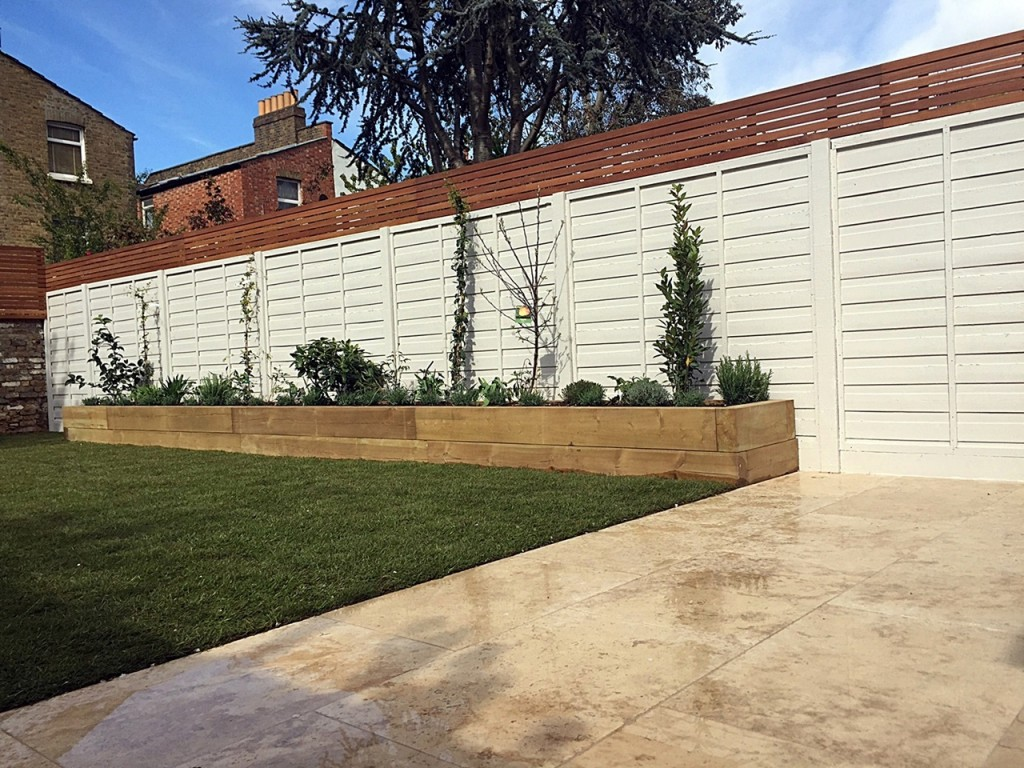 Hardwood privacy screen travertine paving painted fence pastel shade London