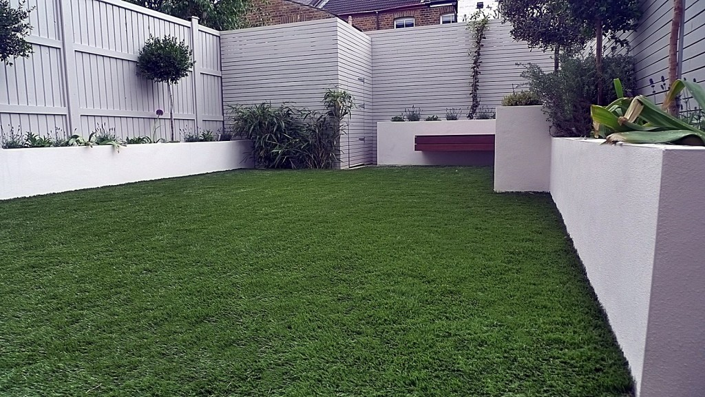 Privacy screen artificial grass lighting painted fences white beds hardwood bench London Chelsea Fulham