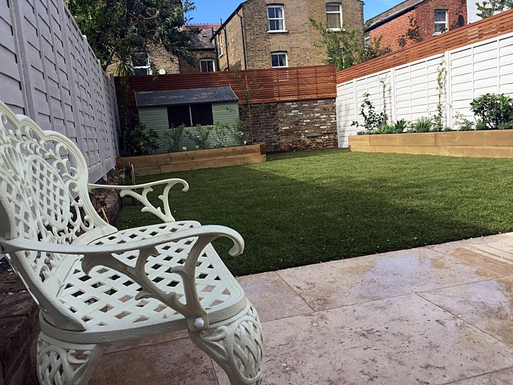 Travertine paving pastel shade painted fence hardwood screen low maintenance London Clapham Balham Wandsworth