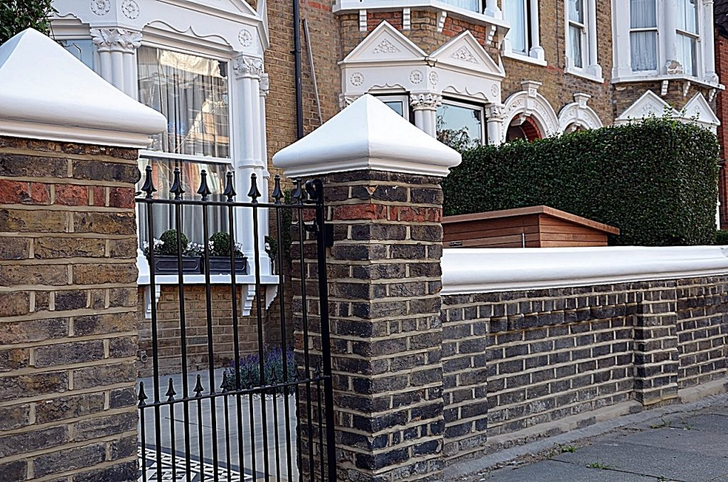 Brick garden wall cap coping white colour iron gate rails path paving London Fulham Chelsea Wandsworth
