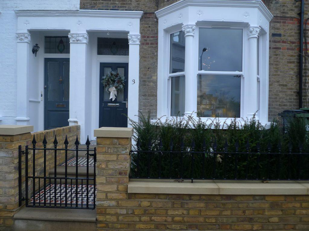 Yellow London brick wall black and white Victorian mosaic ... Black Stone Flower