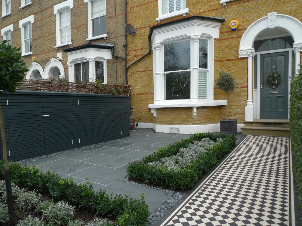 yellow london brick wall black and white victorian mosaic topiary yorkstone peckham bromley