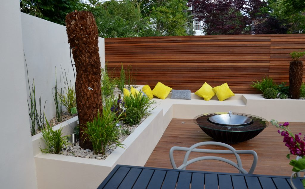 Modern garden design outdoor room with kitchen seating for Modern garden rooms london