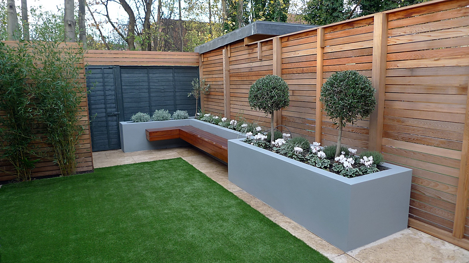 modern garden design small london cedar screen grey raised bed artificial grass cream paving. Black Bedroom Furniture Sets. Home Design Ideas