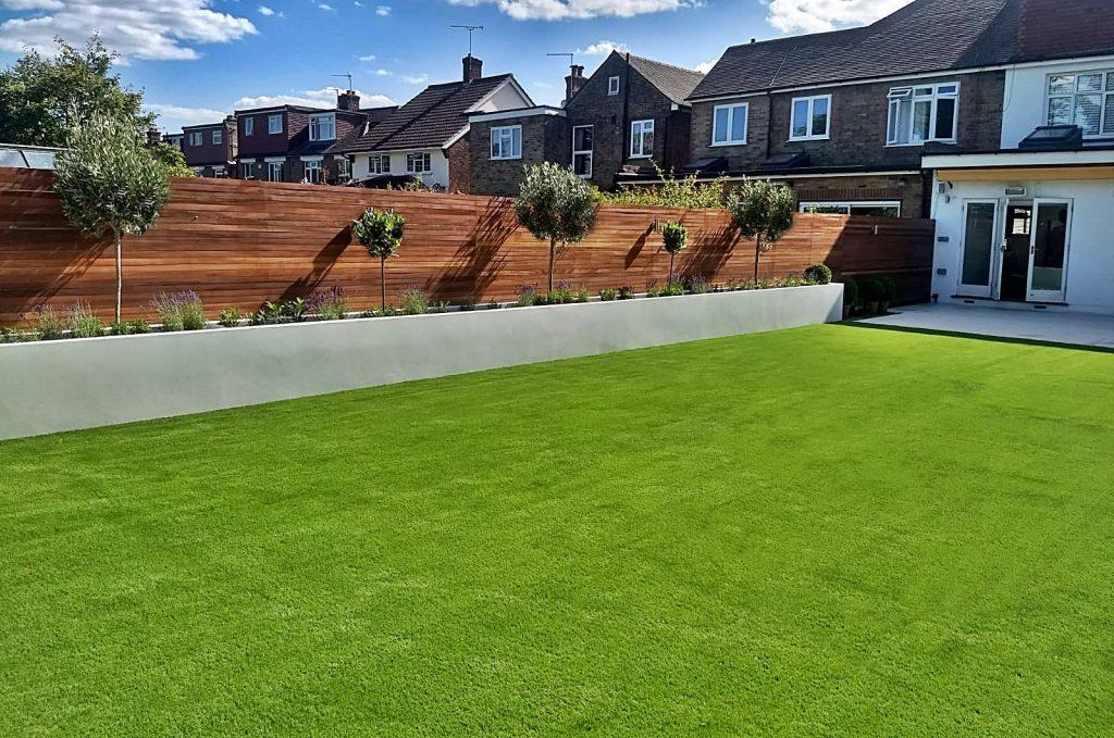 Render raised bed walls porcelain paving artificial grass modern simple elegant garden design West London Isleworth